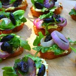 grilled bread, arugula, goat cheese, olives, onions, appetizer