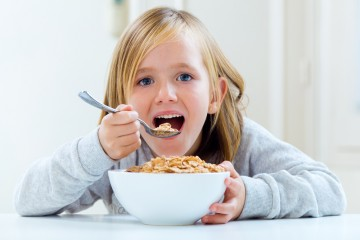 kid girl eating cereal