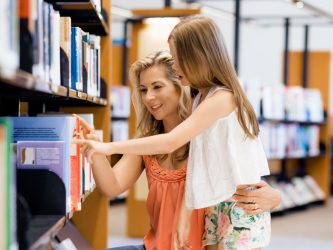 girl and mom choosing book
