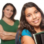 Teen girl and mom empowering girls