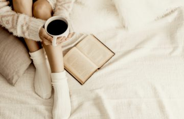 reading in bed with coffee