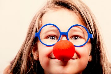 girl in red clown nose