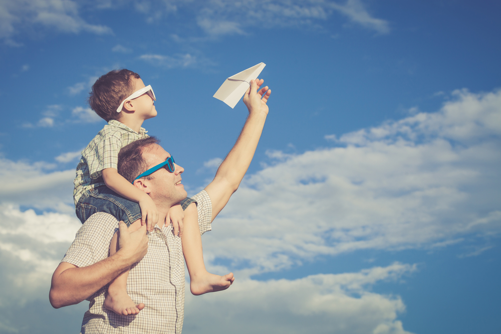 Dad & Son flying airplane