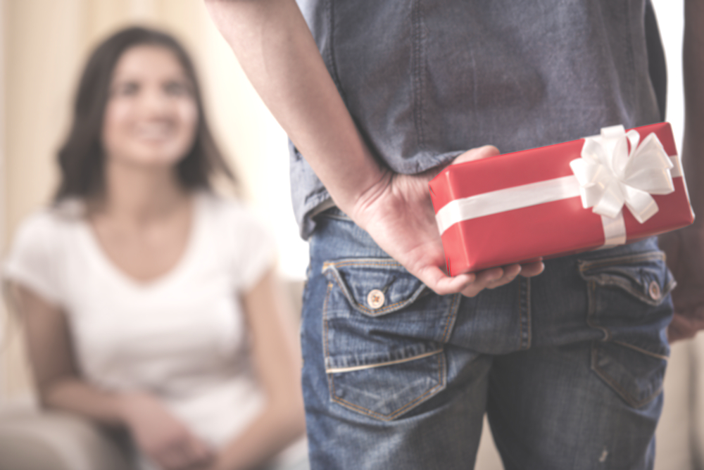 guy man holding gift for woman