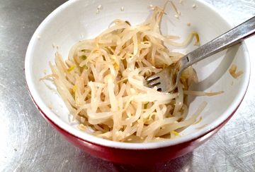 Bean sprouts with sesame oil and sesame seeds.