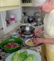 Mom making cabbages. She begged me not to take a photo. Oh well.