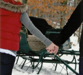 couple sleigh ride snow