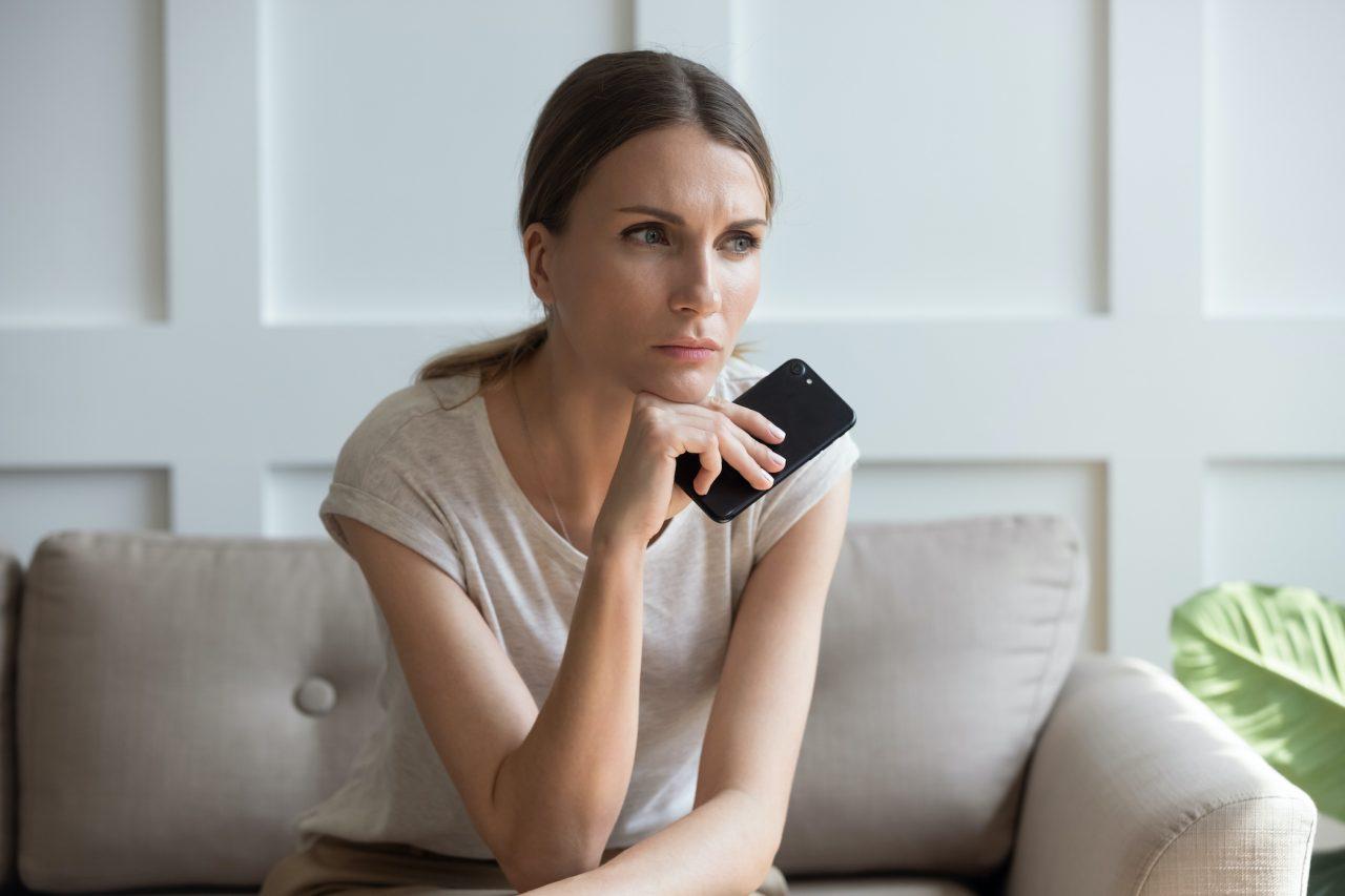 woman deciding, phone, call